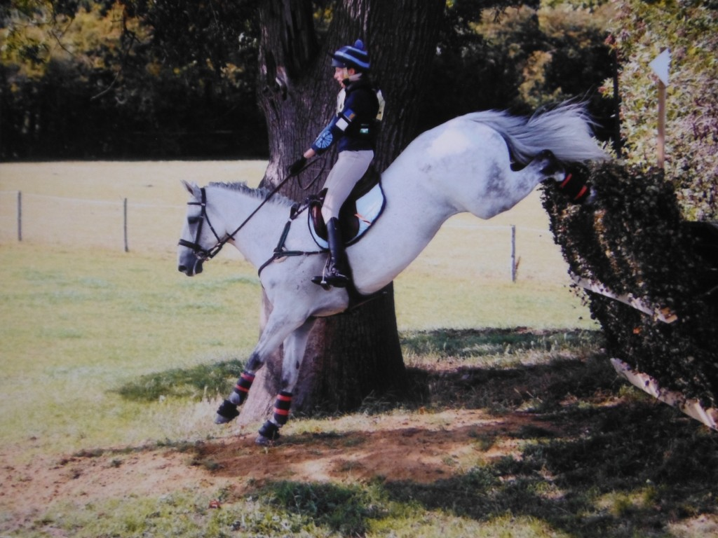 Ella Gay Physio for Suffolk jumping a cross country fence